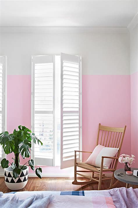 pink bedroom wall with chairs