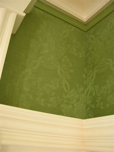 green fabric upholstered walls picture month