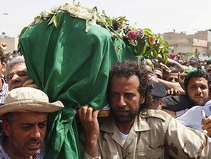 gaddafi funeral staged amid attacks