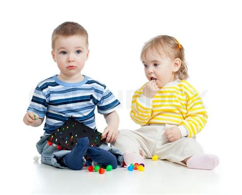 Children Playing Withmosaic Toy Concept For Health Hazard To Small Children Stock Photo Pictures Of Small Children