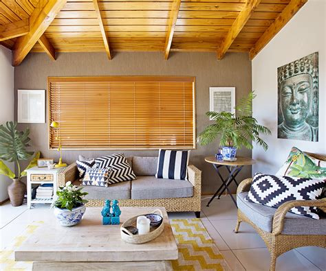 a 1970s style home is redecorated with tropical style decor