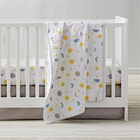 star crib bedding clouds stars sun and moon celestial nursery motifs