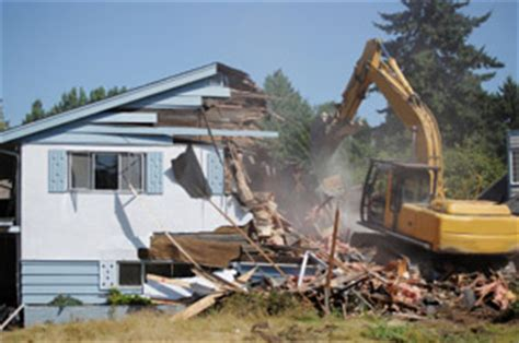 Demolishing A House by Demolition Dismantling Services Underground Storage Tank