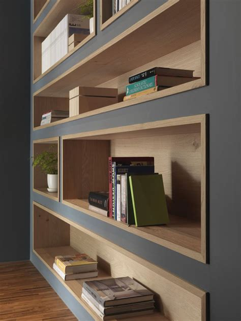 Interior Design For Bookshelves by Built In Bookshelves Lined With Wood Highlight The Displayed Decor Contemporist