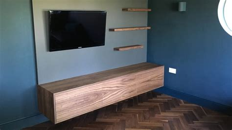 001 media wall with walnut av cabinet stump furniture