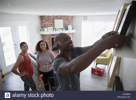 hanging family pictures in living room picture with family stock photos picture