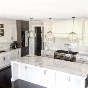 white marble kitchen island white and gray kitchen cabinets with antiqued mirrored