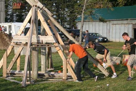 backyard trebuchet build a trebuchet and launch flaming pumpkins badge of