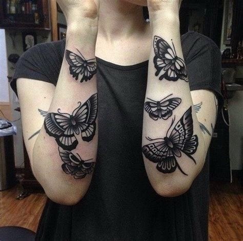 realistic girly black ink butterfly tattoo on forearms