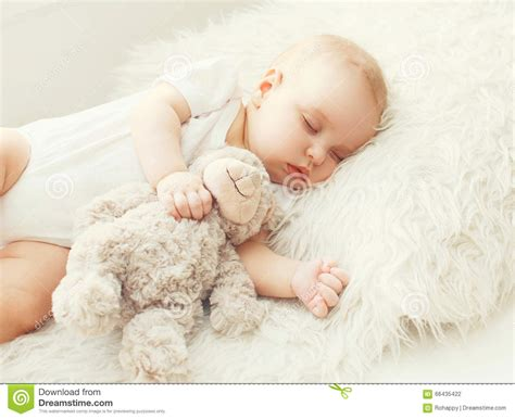 baby sleeping bed cute baby sleeping on soft bed home stock photo image