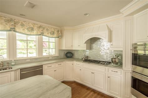 soft white custom cabinets in ct transitional kitchen
