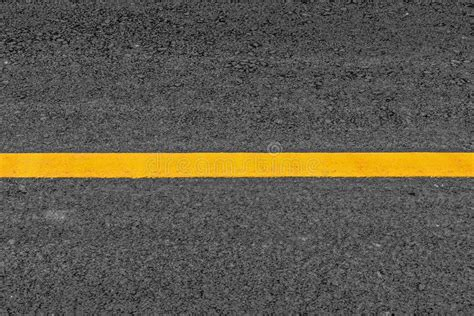 pattern of yellow lines on the roadway yellow line on asphalt texture road background with grainy
