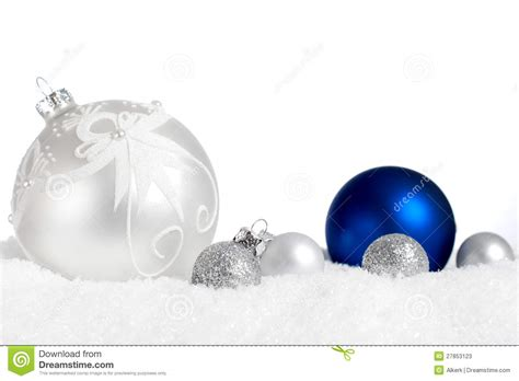 silver and blue ornaments in snow stock image image