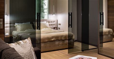 define bedroom glass doors define the bedroom in this small apartment