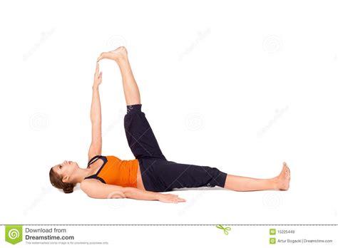 reclining big toe woman practicing reclining big toe yoga pose royalty free