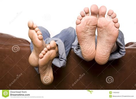 feet on couch man and woman feet over couch stock photography image