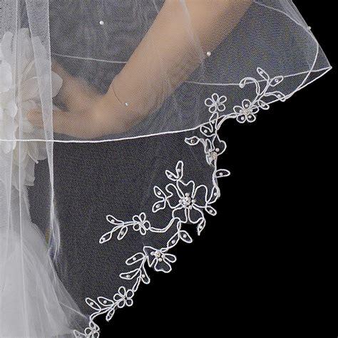 flower pattern veil two tier fingertip length veil w flower pattern pencil