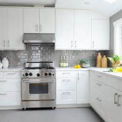 tiled backsplash design with white marble countertops and a gray subway