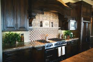 kitchen backsplash glass tile dark cabinets dark wood