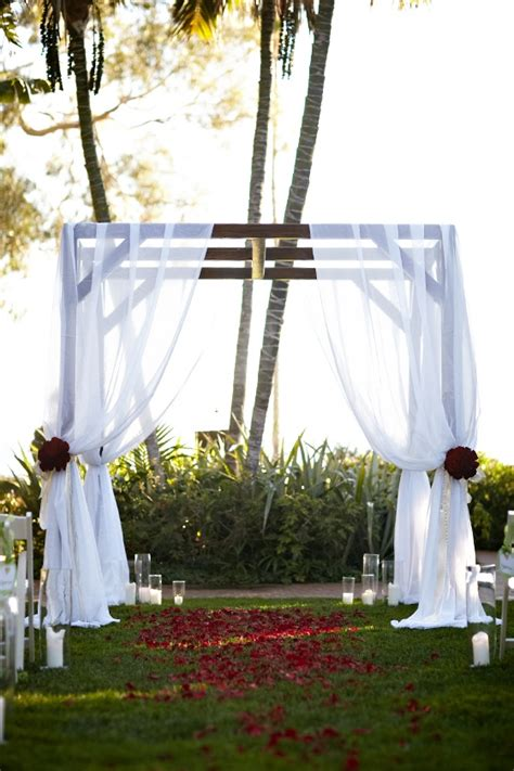 draped wedding arch sheer draped wedding arch with red roses at the four
