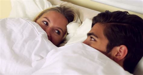 cute couples in bed cute young couple asleep together on bed at home in