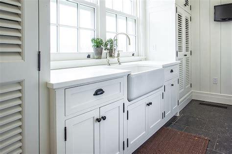 White Laundry Cabinets With Shiplap Backsplash White Cabinets Laundry Room