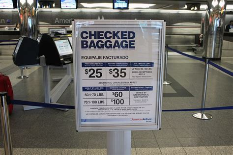 american checked bag fee a flight within the us new york miami with american airlines