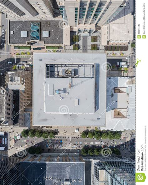 drone aerial still of rooftop high rises in the city of