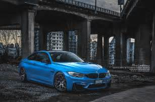 yas marina blue bmw m4 with smoke black brixton wheels