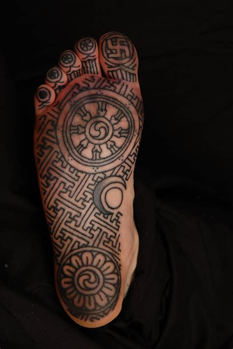 swastika tattoo shane tattoos buddhist design on sole of foot