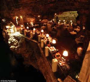 cave resturuant side of a cliff italy grotta palazzese stunning restaurant built inside a cave