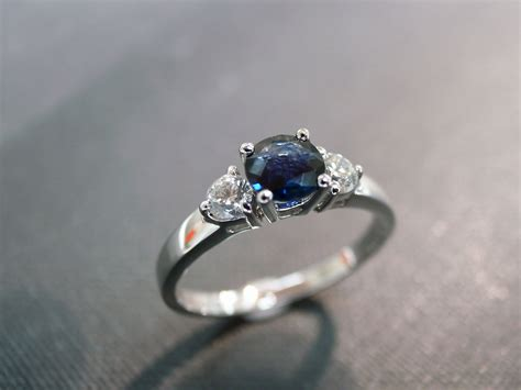 engagement ring with and blue sapphire in 14k