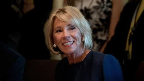 betsy devos job it s betsy devos job to protect students from predatory