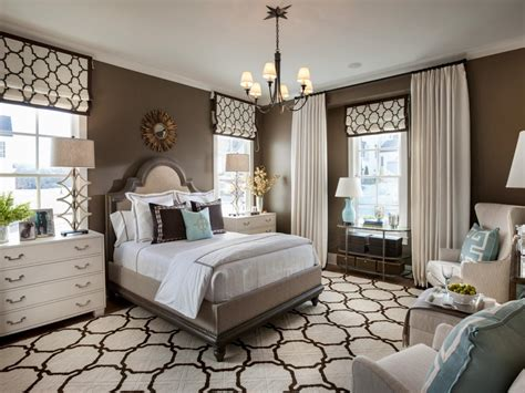 transitional style bedroom in brown with blue a bold pattern repeated on the shades as