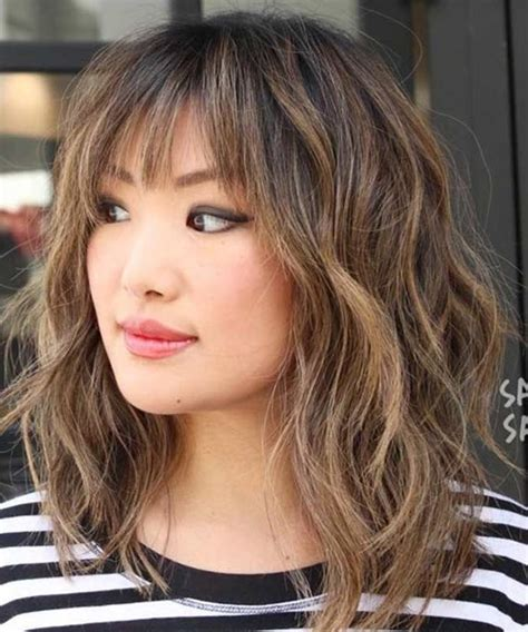 Wavy Hairstyles With Bangs by Thick Wavy Hairstyles With Bangs For With Medium