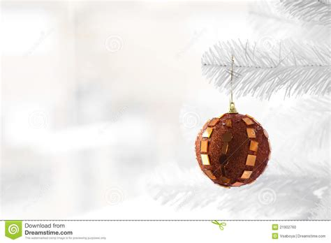 orange bauble on christmas tree stock photo image 21902760