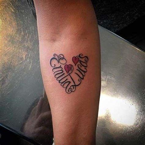 tatuaggi lettere con cuore tatuaggi con nomi intrecciati foto nanopress donna