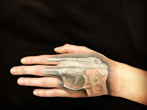 gun tattoo on finger meaning best gun tattoo meaning and ideas chhory tattoo
