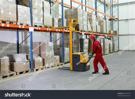 Warehouse Forklift Operator by Manual Forklift Operator Work Warehouse Stock Photo 50796190