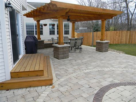 patio with wooden steps and stone wall by culvers garden