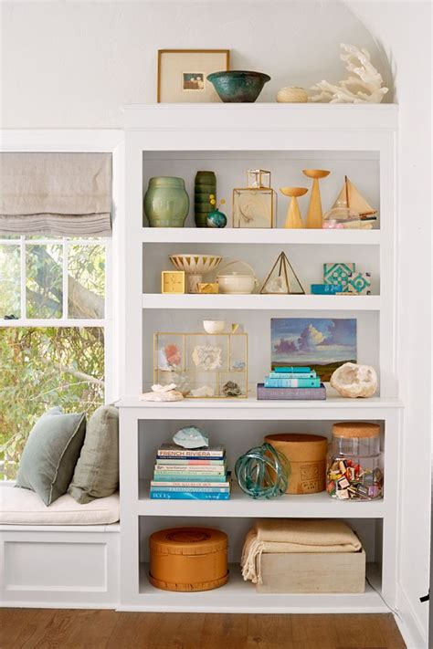 how to style your bookcase if you re a collector styling