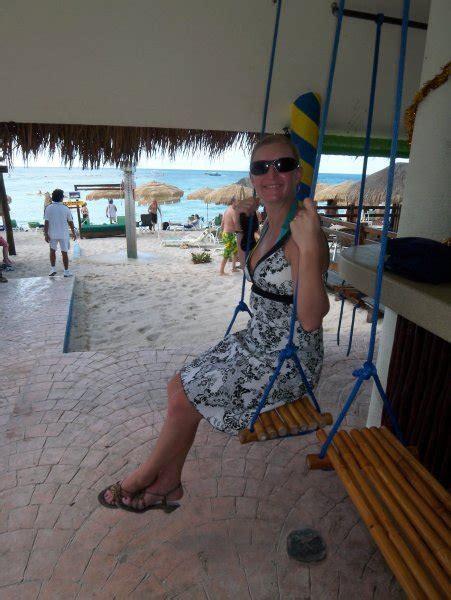 cozumel beach bar swing seat photo