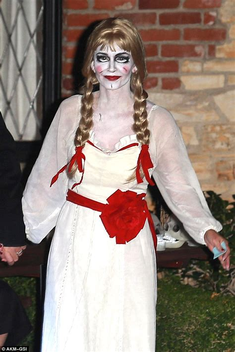 annabelle doll killer courteney cox unrecognisable dressed as killer doll