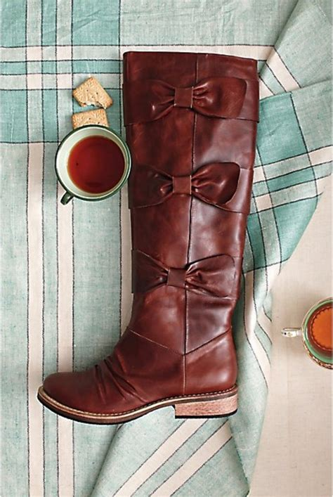Shoes: brown boots, bows, anthropologie, boots, riding