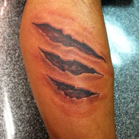 dreamlike forearm tattoo 5 torn skin forearm tattoo on