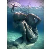Anorak  Ocean Atlas Huge Underwater Statue Of Girl Holding The Seas
