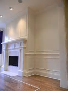 Custom fireplace mantel with wainscoting and crown moulding