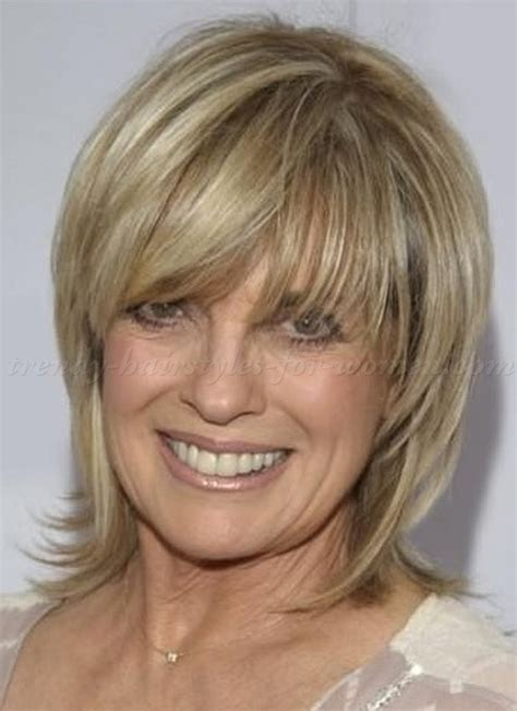 layered medium haircuts for 50 medium length layered hairstyles women over 50