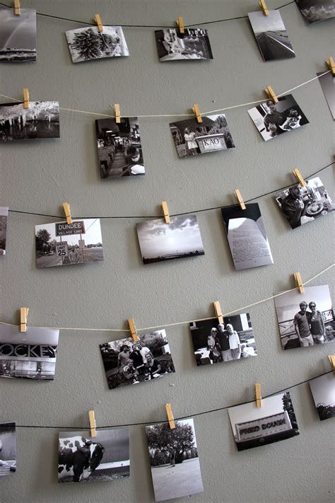 how to put stuff on wall without nails diy mini clothespin picture display niftythriftygoodwill