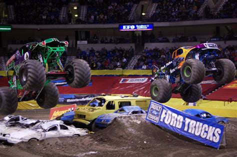 monster truck rally videos grave digger and black stallion battle it out in monster